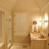 Bath with paneling and tall ceiling