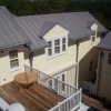 Aerial view of roof, siding and deck